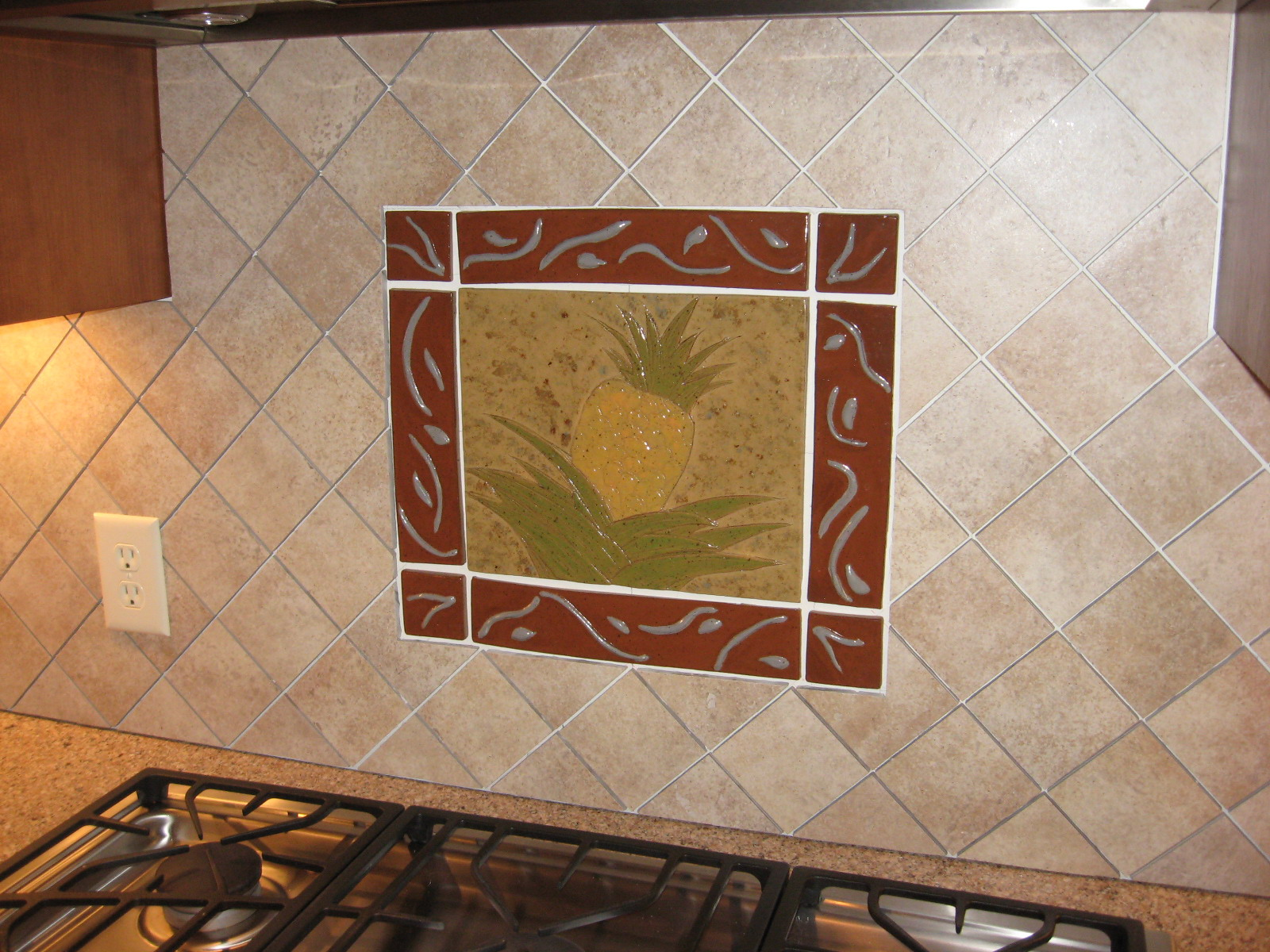 Backsplash completed - custom pineapple deco.