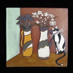 black and white cat with flower vases