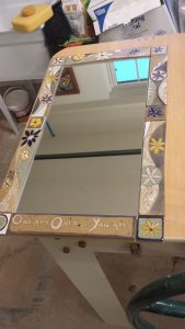 Handmade ceramic tile mirror frame. Colorful, floral, blue, white, yellow, sage green stoneware with floral design.