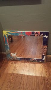 Bright and colorful ceramic tile mirror frame with sun, water, transitioning to night scene at bottom.