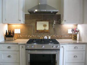 Kitchen backsplash with handmade palmetto and crescent mural.