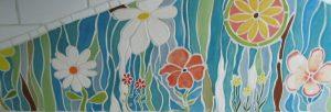 Handmade ceramic tile backsplash, floral mosaic, blues, white, yellow, and red flowers, etc.